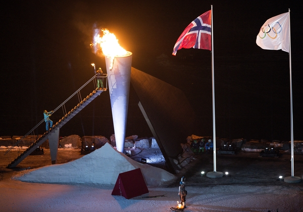 The Norwegian Flag and the Olympic Flag fly over Lysgårdsbakkene Ski Jumping Arena as the flame of the Lillehammer 2016 Winter Youth Olympic Games gets delivered to the cauldron by Her Royal Highness Princess Ingrid Alexandra of Norway during the Opening Ceremony, Lillehammer, Norway, 12 February 2016. Photo: Jon Buckle for YIS/IOC Handout image supplied by YIS/IOC