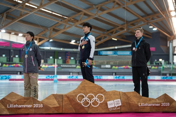 Men's 1500m Speed Skating Gold medalist Min Seok Kim KOR, Silver medalist Daichi Horikawa JPN and Bronze medalist Daan Baks NED on the medal podium at the Hamar Olympic Hall Viking Ship during the Winter Youth Olympic Games, Lillehammer Norway, 15 February 2016. Photo: Thomas Lovelock for YIS/IOC Handout image supplied by YIS/IOC