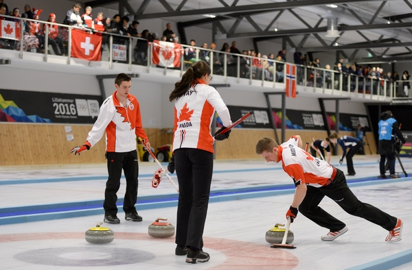 Tyler Tardi, Mary Fay and Sterling Middleton CAN in action during the Gold Medal Game of the Curling Mixed Team Finals at the Lillehammer Curling Hall during the Winter Youth Olympic Games, Lillehammer Norway, 17 February 2016. Photo: Thomas Lovelock for YIS/IOC Handout image supplied by YIS/IOC